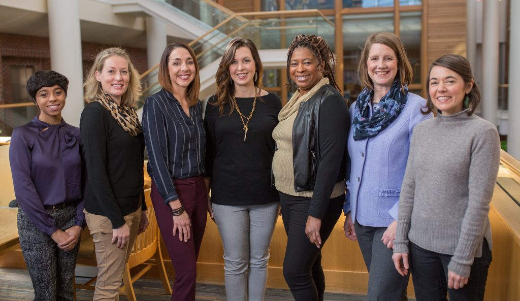 Members of the ENRICH project team smile together in Armfield Atrium. Catherine Sullivan, director of the Carolina Global Breastfeeding Institute, is second from the right.
