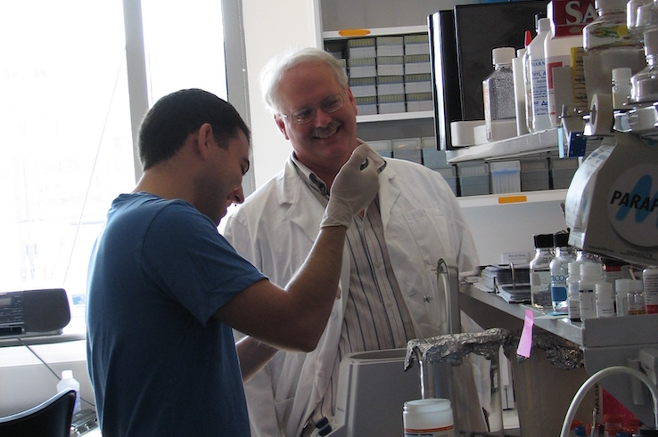 Dr. Ralph Baric works in his lab with a student.
