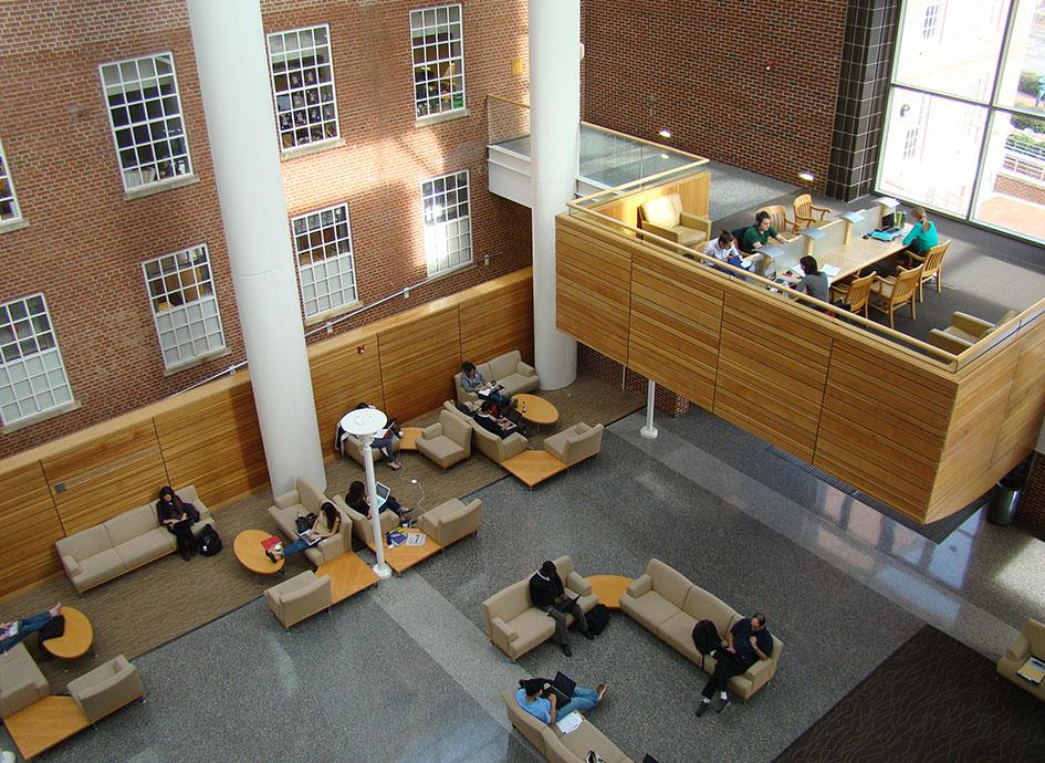 Students take a study break in the atrium.