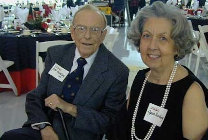 Dr. Joan Huntley smiles with her husband, Robert, at a public event.