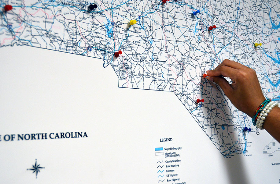 A member of NCIPH places a pin on the North Carolina map.