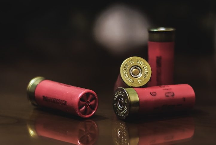 Shotgun shells rest on a tableShotgun shells rest on a table..