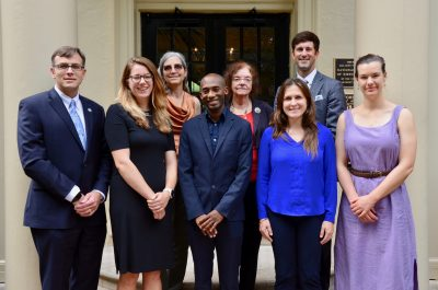 "Dr. Lanakila ""Ku"" McMahan (center front) smiles with students, faculty members, staff and alumni of the Gillings School."