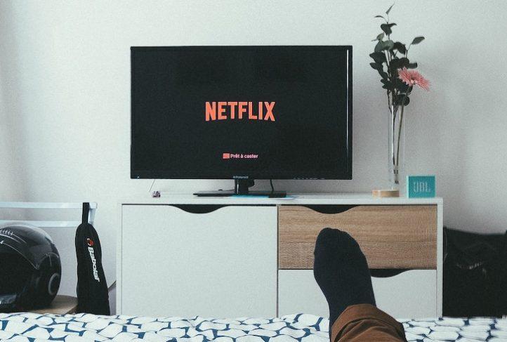 A man watches Netflix.