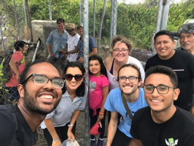 A group of UNC Gillings students and locals study water quality in the Galapagos Islands. Left to right in the foreground are: Khristopher Nicholas; Valeria Ochoa-Herrera; Romina; Chelsea Philyaw; Elijah Watson (with glasses); and Kishan Patel (also with glasses at the front right). Gabriel is behind Kishan (he is a government worker who helped recruit many households to the study). Manuel is at the back right (he is the mayor of Isabela). (Contributed photo)