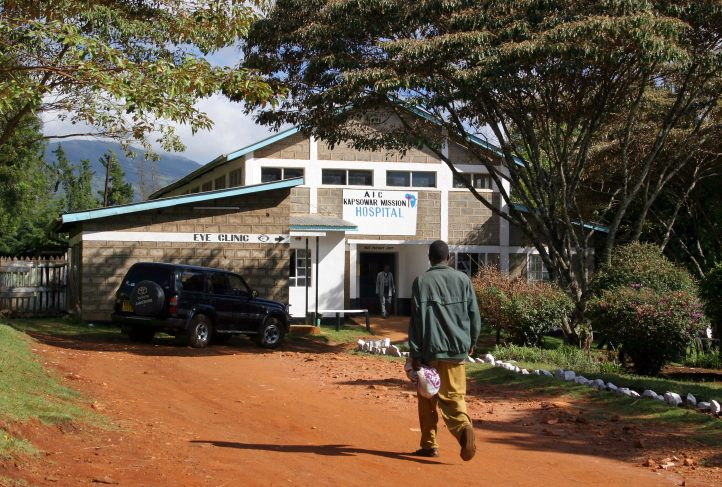 A man walks toward a hospital in Kenya.