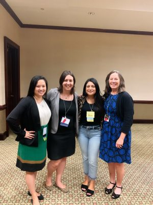Veronica Pham, Jessica Johnson, Melissa Renteria, and Dr. Anna Schneck smile together at the NCPHA Conference.