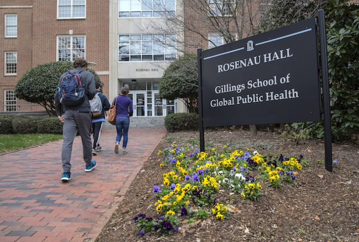 Students walk towards Rosenau Hall at the UNC Gillings School of Global Public Health on March 1, 2018, in Chapel Hill. (Johnny Andrews/UNC-Chapel Hill)