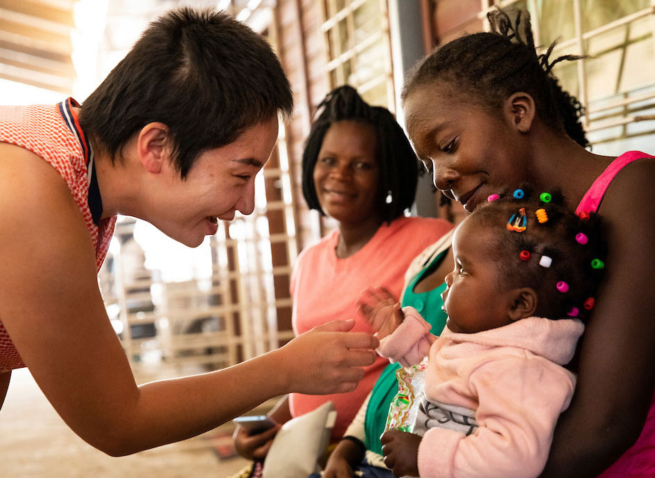 Munguu meeting the littlest patient in Lusaka, Zambia.