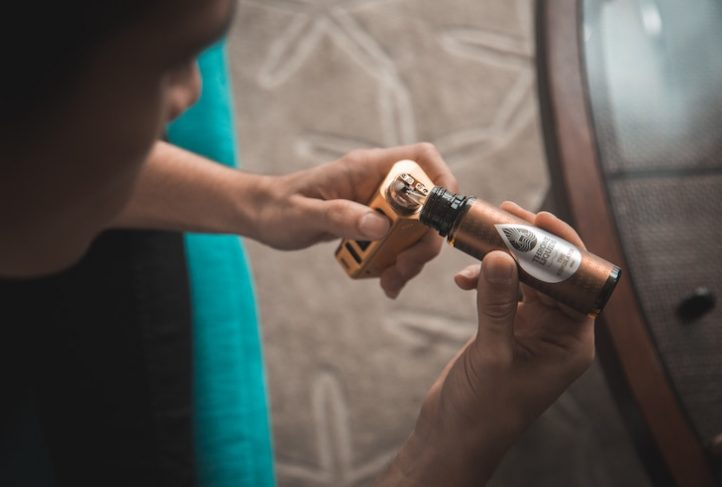 An e-cigarette user refills their device.