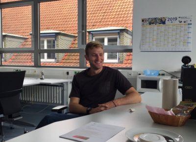 Casey McGoun smiles during a meeting at Ruhr University.
