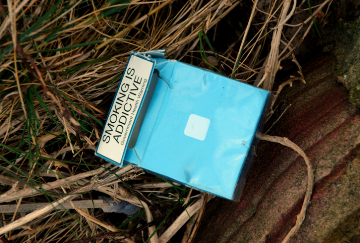 A label on a cigarette pack warns of smoking's addictiveness.
