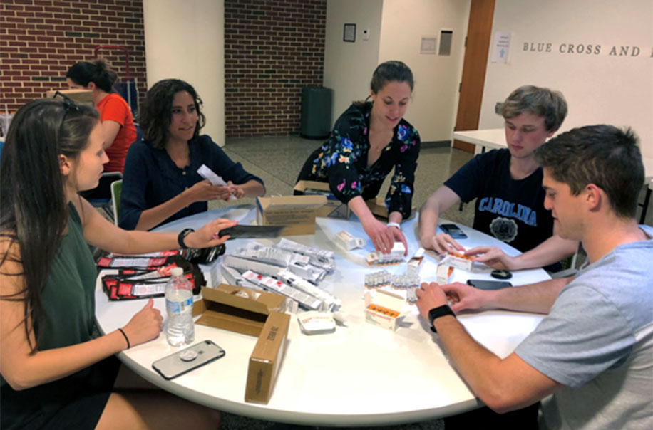 Students build Naloxone kits.