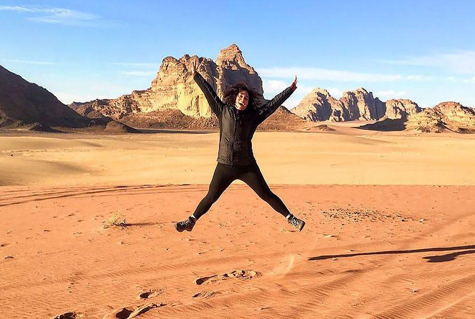 Lein Soltan jumps in the desert.