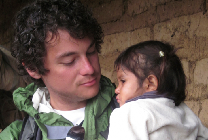 Andrew Herrera holds a severely malnourished girl he met in rural Guatemala. To him, she represents completely unnecessary suffering that, for a low cost, can be eliminated.