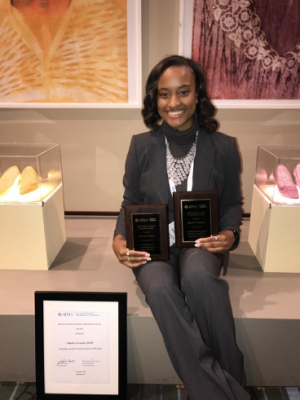 Makala Carrington poses with awards she received at the 2019 APHA Annual Meeting.