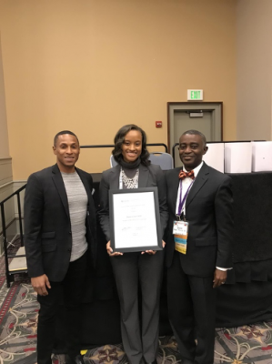 Makala Carrington (center) poses with her award and a group of APHA members.