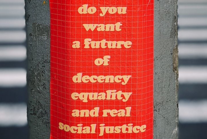 A sign on a street pole promotes equity.