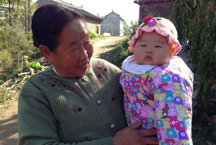 A grandmother holds a baby in a rural Chinese village. (Photo courtesy of Dr. Sean Sylvia)