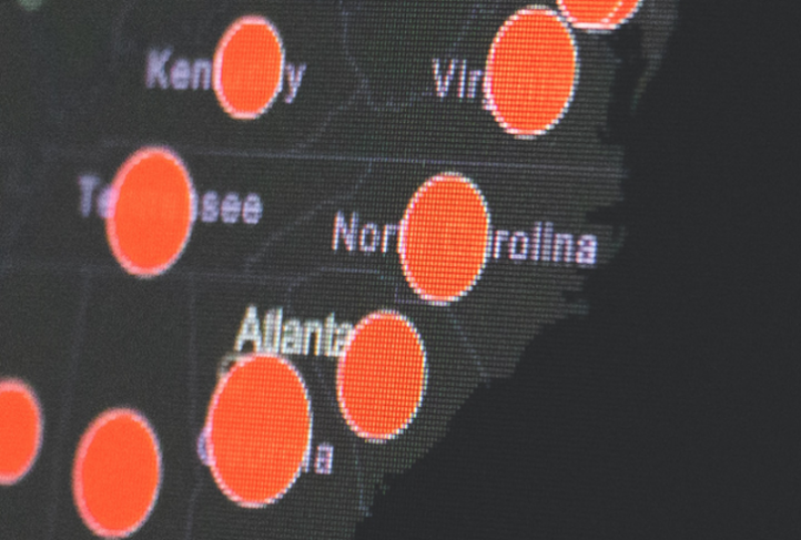 A screen displays a COVID-19 tracking map for the southeastern United States