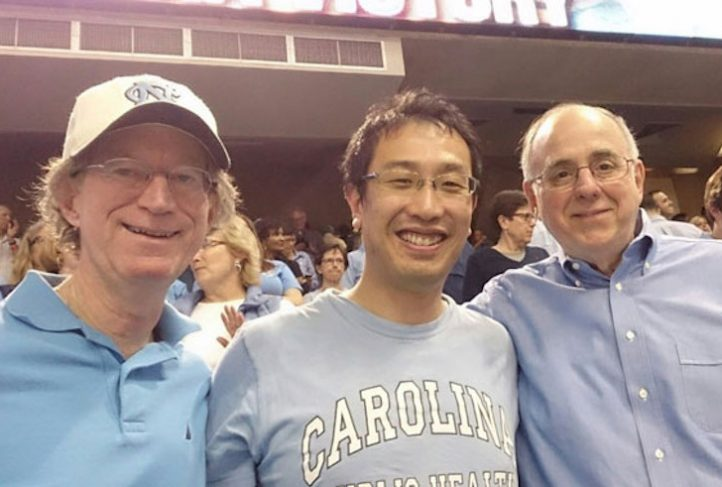 (L-R): Drs. David Steffen, Hajime Kanamori and Bill Sollecito attend a UNC basketball game.