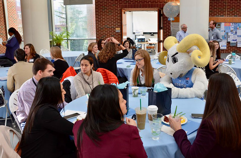Students chat with Rameses at MPH@UNC Immersions.