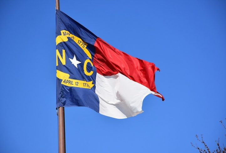 The North Carolina state flag waves in the breeze.