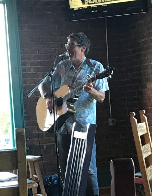 Dr. Meshnick plays guitar at the Carrboro Music Festival.