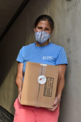 Eleanor Wertman holds one of the emergency food boxes that are being delivered through the food hub.