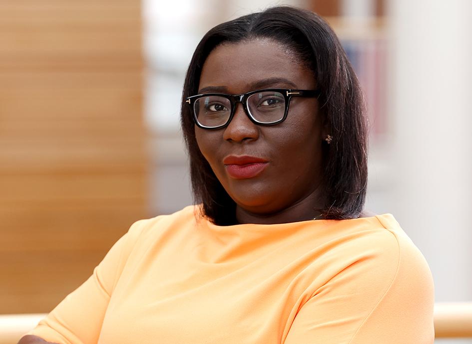 Janet Okraku-Mantey standing with arms crossed.
