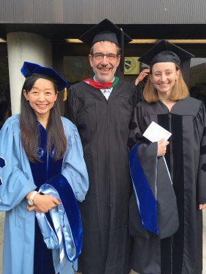 Dr. Meshnick celebrates two new graduates.