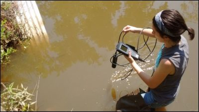 Dr. Christenson-Diver conducts water sampling.