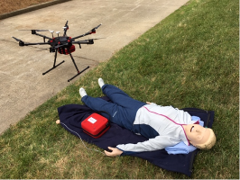 A drone arrives at the scene of a simulated cardiac arrest.