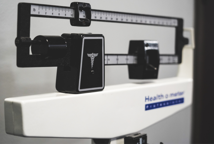 A scale measures a patient's weight.