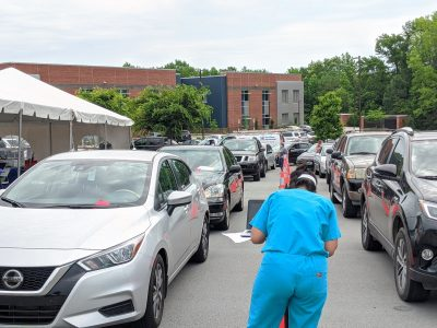 Cars line up for drive-through COVID-19 testing