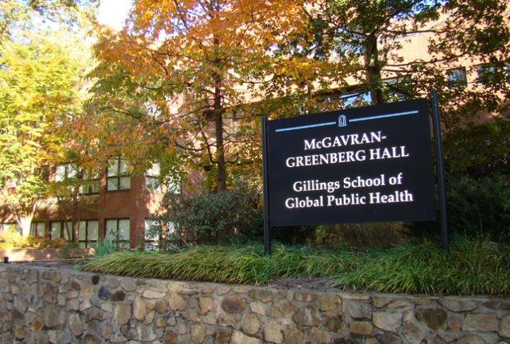 A sign welcomes visitors to the McGavran-Greenberg Hall entrance of the Gillings School.
