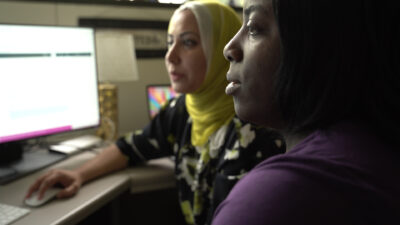 Monisa Aijaz (left) and Heather Wire (right) work on a project.
