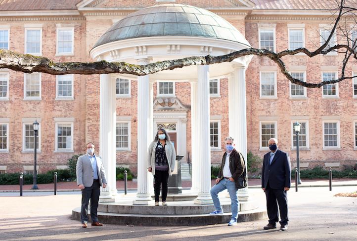 Members of the I4 Boundary Spanners program at UNC stand by the Old Well.