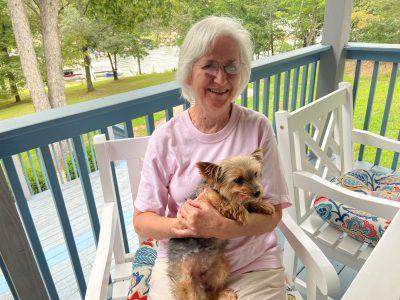 Dr. Brenda Edwards holds her dog.