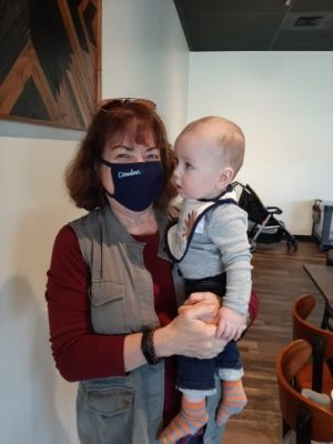 Dr. Dorothy Cilenti wears a Carolina mask while holding her grandson.