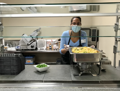 Ivonne Headley serves up Spanish-inspired shrimp and rice as part of a monthly cultural heritage dish.