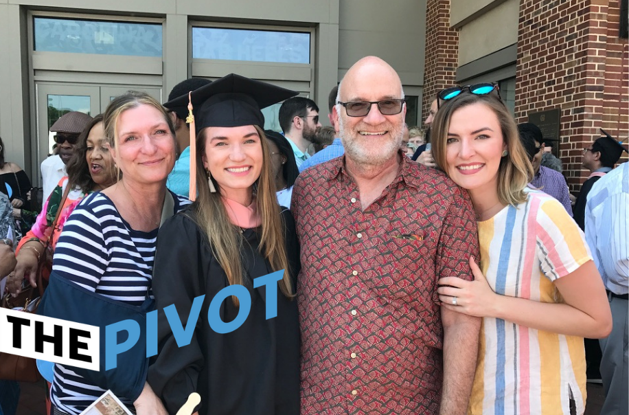 Jenna McCready (in master's gown) smiles with her family after commencement.