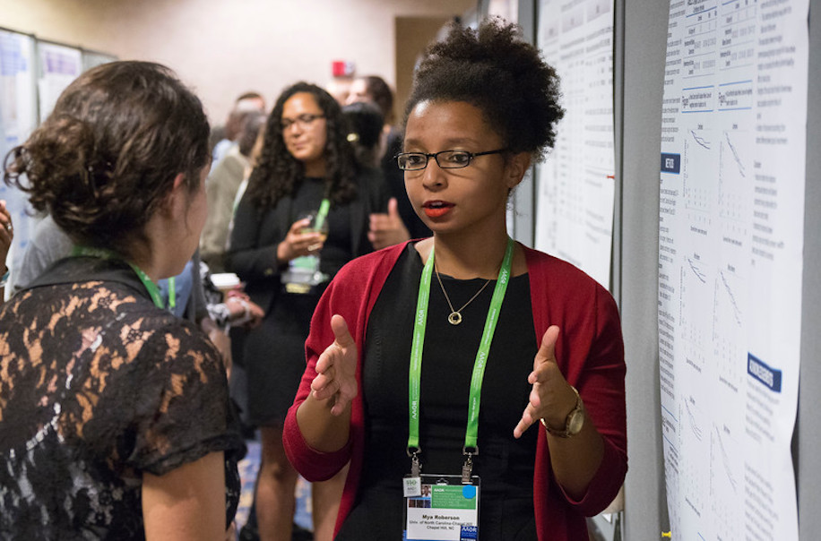 Mya Roberson presents research during the Opening Poster Session at the 10th AACR Conference on The Science of Cancer Health Disparities in Racial/Ethnic Minorities and the Medically Underserved.