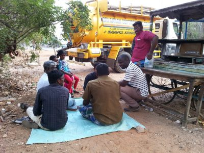 Manga meets with sanitation service providers in Trichy to assess how the community's sanitation systems are managed.