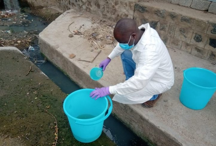 Musa Manga collects water samples