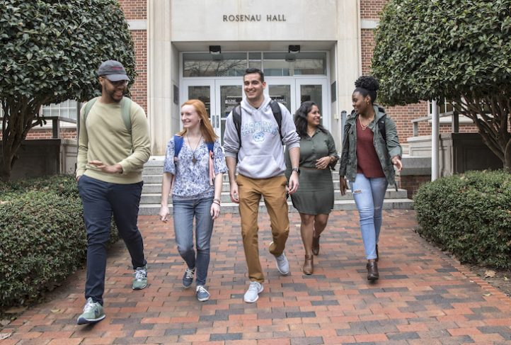 (From left) Samuel Baxter, a third year PhD student in health policy, Sarah Zelasky, a senior majoring in environmental health, Abhinav Sehgal, a senior majoring in nutrition, Dharitri Shah, a second year graduate student, and Jeliyah Clark, a senior majoring in environmental health sciences, walk out of Rosenau Hall at the UNC Gillings School of Global Public Health on March 1, 2018, in Chapel Hill. (Johnny Andrews/UNC-Chapel Hill)