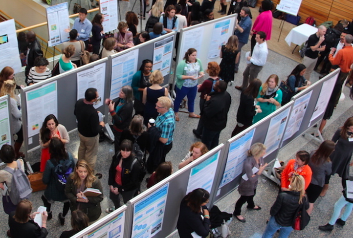 Participants gather at a research symposium.