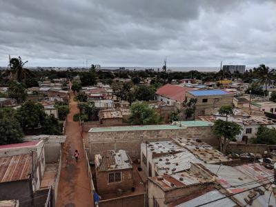 A person walks through an informal community in Maputo, Mozambique.