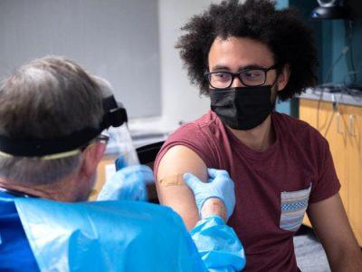 Student Richard Biggs gets his first dose of the Moderna vaccine. (Glenn Asakawa/University of Colorado)