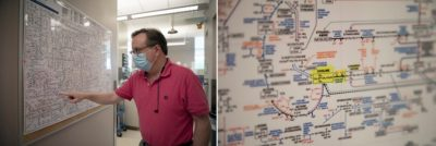 """Walter Friday, a research technician in the Trujillo Lab, points out choline on a chart of metabolic pathways that hangs in the lab. """"I bet you didn't know that your body was doing all of this all the time,"""" he says. (Photos by Alyssa LaFaro)"""